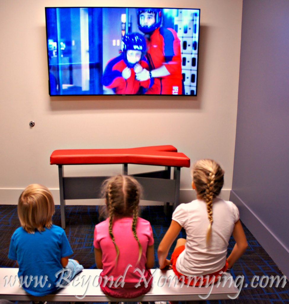 Kids going through the safety presentation before flying at iFLY Fort Lauderdale