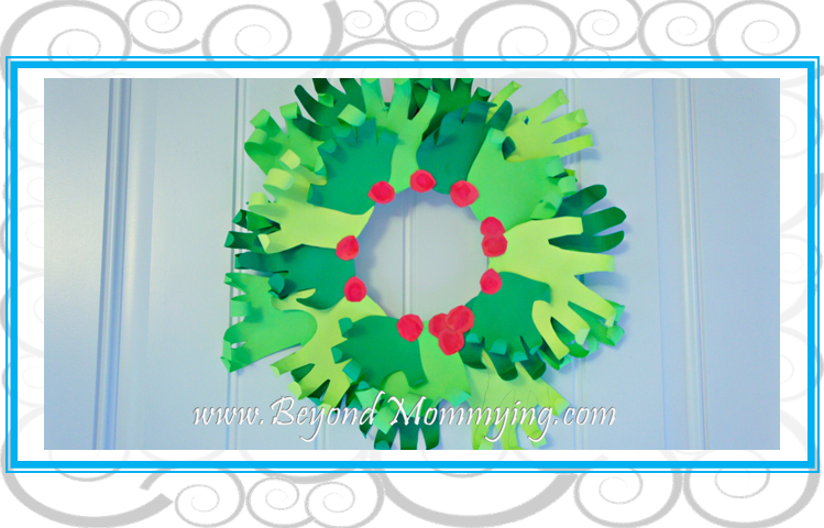 Simple and cute handprint wreath paper craft. Easy enough for older kids to make on their own, it's the perfect family heirloom holiday decoration.